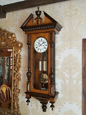 Antique 2 weight Vienna regulator wall clock of small proportions walnut case.