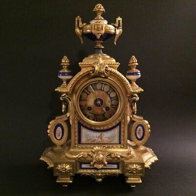 Porcelain bronze clock with medallions.19th century. In good working condition!