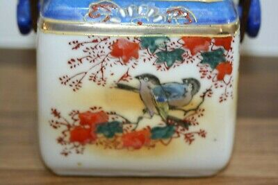 Vintage Japanese pot with wicker handle. Sweet little Bluetits bird decoration