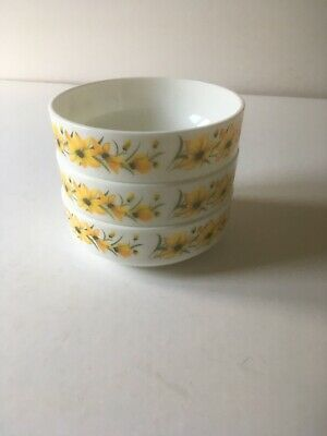 A Set Of Three Matching Vintage, Pyrex Bowls With Yellow Flowers all Around.