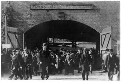 Winchester Repeating Arms Company,1897,men exiting brick building,archway