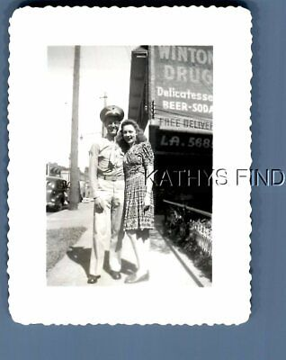 Found B&W Photo N+8882 Soldier Posed With Pretty Woman In Dress