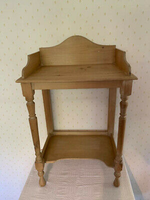 A small stripped pine washstand.