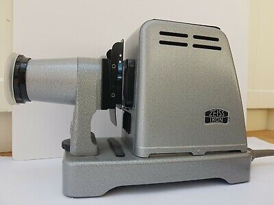 Vintage Zeiss Ikon Ikolux 150 Slide Projector. Original instruction book & box