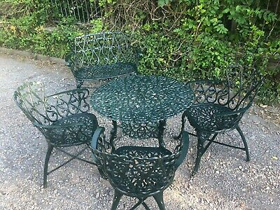 Heavy Cast Iron Table & 3 Armchairs  & matching bench