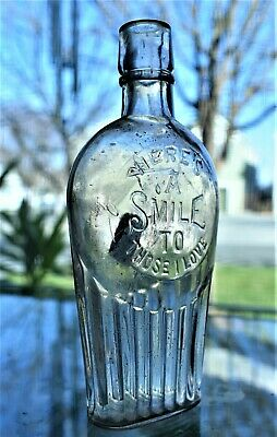 """""""Here's a smile to those I love"""" In a circle, base embossed L.C.&R. 2 piece mold"""