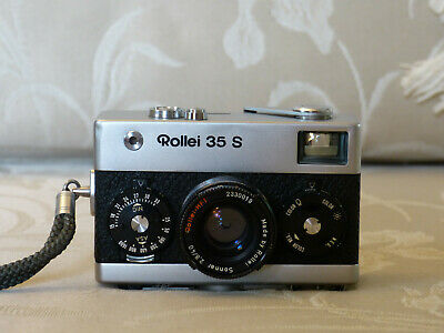 Rollei 35S Camera with manual and Braun 200bc flash