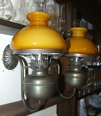 Pair of vintage electric oil lamps wall lights mustard shades Lightique retro