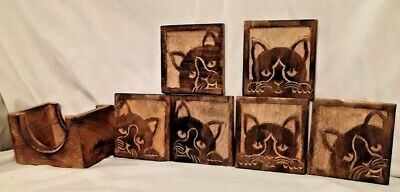 Set of Six Stunning Handcarved Coasters with Cats including holder for them.