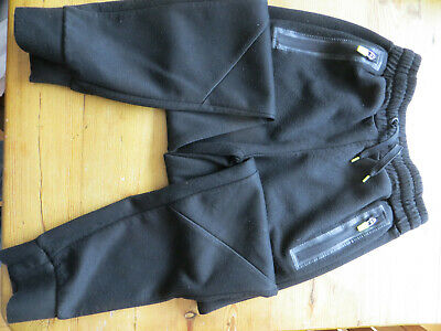 girls age 11/12 track bottoms side zips used good cond