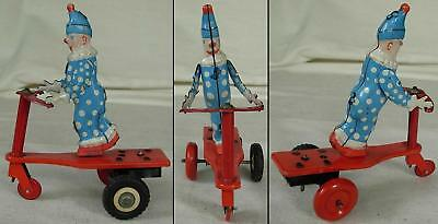 VINTAGE WIND-UP TOY - CLOWN ON SCOOTER, HUNGARY, 1970s