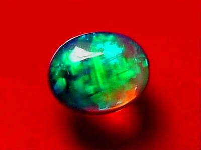 Outstanding Bright Top Colour Pattern Stunning Solid Black Crystal Opal 1 carat.