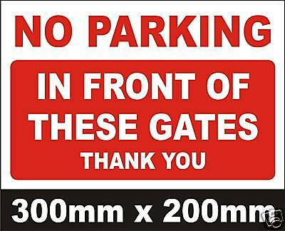 No Parking In Front Of These Gates Sign - Rigid Plastic