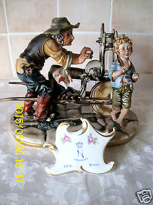 Capodimonte Figure Of A Youg Boy With His Dad Sharpening Items Sculptor Milio