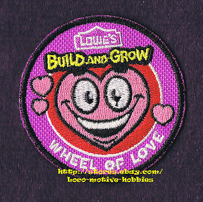 LMH PATCH Badge 2013 WHEEL OF LOVE Heart Luv Smile  LOWES Build Grow Kids Clinic