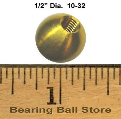 "Five 1/2"" dia. threaded 10-32 brass balls drilled tapped"