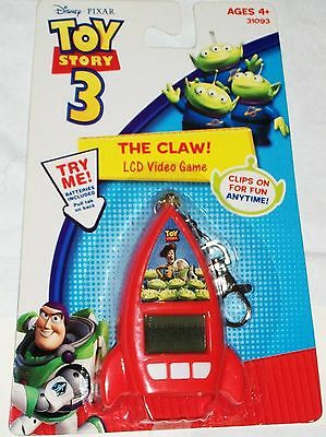 Disney-Pixar Toy Story 3 LCD The Claw Video Game Keychain by: Techno Source