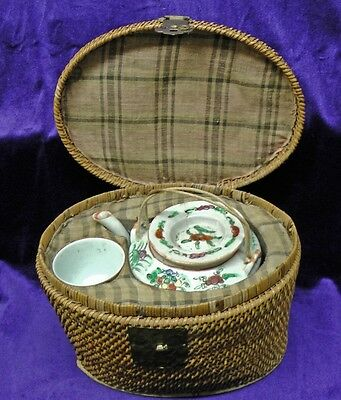 Antique Chinese Teapot and Cup in Wicker Basket