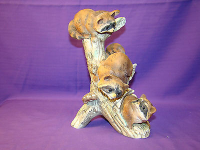 CUTE MASTERPICE PORCELAIN FIGURINE OF THREE RACOONS PLAYING IN HOLLOW TREE STUMP
