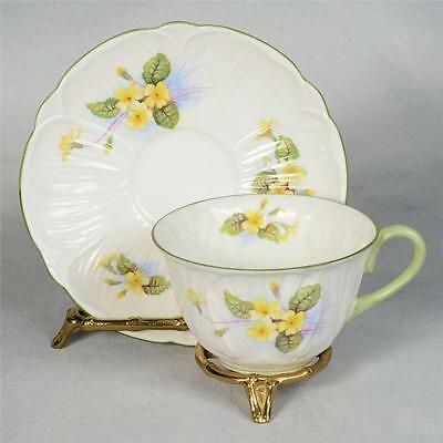 SHELLEY TEACUP & SAUCER - OLEANDER SHAPE, WHITE DECORATED WITH YELLOW PRIMROSE