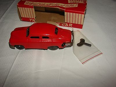 VINTAGE PUZZLE CAR WIND UP TIN TOY CAR VERY COOOOL