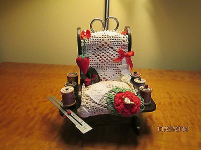 vintage pin cushion with wood thread spools and more