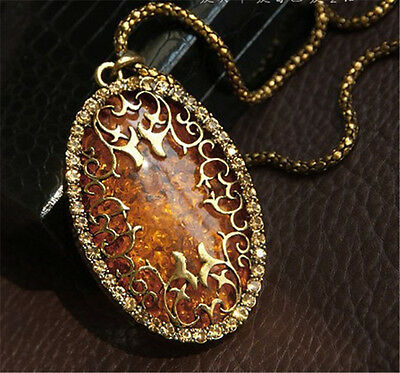 Vintage Womens Amber Hollow Rhinestone Oval Long Chain Pendant Necklace Jewelry