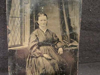 Seated woman with hoop skirt in front of lattice window antique Tintype Photo