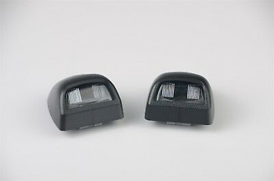 Dorman 68168 fits Chevy GMC License Plate Lens Black - Pair