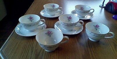 ROYAL SWIRL FINE CHINA OF JAPAN, 4 SAUCERS & 6 FOOTED CUPS, MS 109?