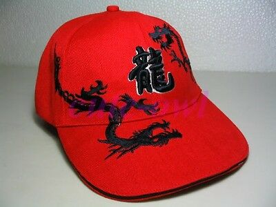 Red sporting hat with black embroidered dragons and Chinese symbols