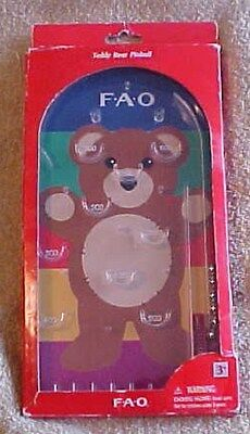 "Teddy Bear Pinball, FAO, 2011, for ages 3+, measures about 5 3/8"" x 10 1/2"" x 1"""