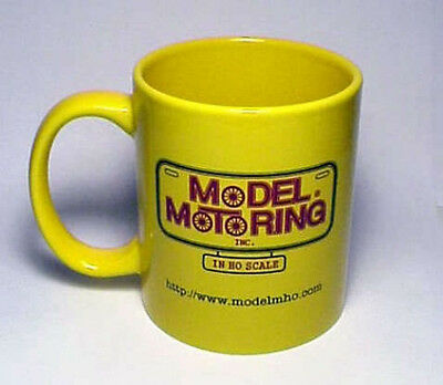 MODEL MOTORING 11 OUNCE GLOSSY CERAMIC COFFEE MUG.