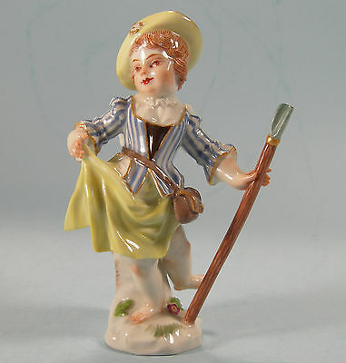 Early Meissen Cupid Figure in the From of a Little Girl with Staff Yellow Hat
