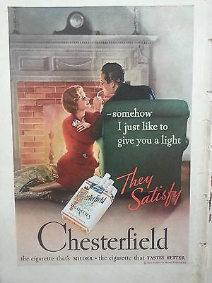 1934 Chesterfield Cigarettes Romantic Woman Man Smoking by Fireplace Ad