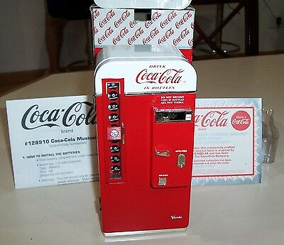 "1994 Coca Cola Enesco Metal Collectible Musical Bank  "" It's The Real Thing """