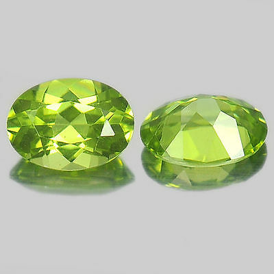 A PAIR OF 6x4mm OVAL-FACET STRONG-GREEN NATURAL AFGHAN PERIDOT GEMSTONES