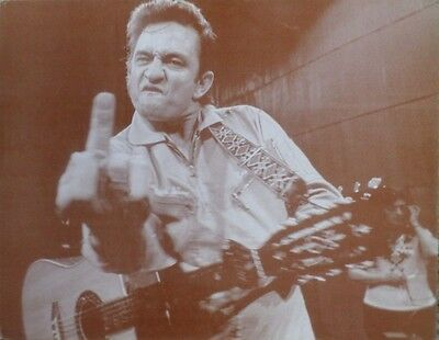 Johnny Cash on stage giving the finger Sepia Poster