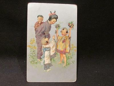 Oriental Woman with Three Children Including Baby on back Early 1900s Postcard