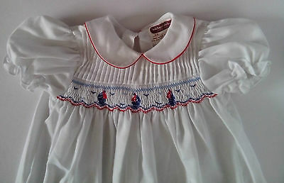 a Michael de leon  White Short Sleeved Dress with smocking size:1-2 years 1985