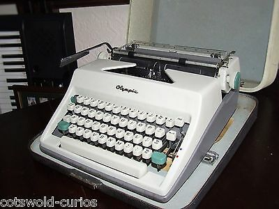 Olympia SM8 Portable Typewriter (1967) with travel case
