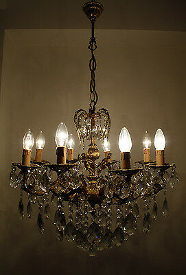 Antique 8 arms 8 lights Cast Brass & Crystals Cherub Chandelier from 1950's