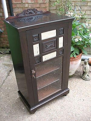 Old antique Victorian mahogany glazed cabinet bookcase on ceramic castors