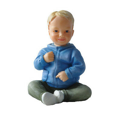 Dolls house figure, 1/12th scale poly/resin young boy sitting named Daniel