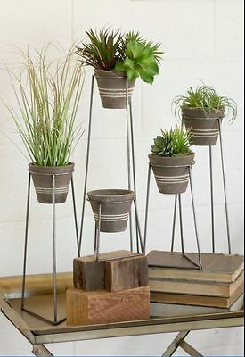 Set Of 5 Clay Pots With Wire Bases