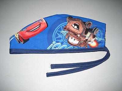 "Surgical Scrub Hats caps Disney's ""Cars"" on blue fabric"