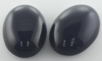 A PAIR OF 14x10mm OVAL CABOCHON-CUT NATURAL AFRICAN JET-BLACK ONYX GEMSTONE