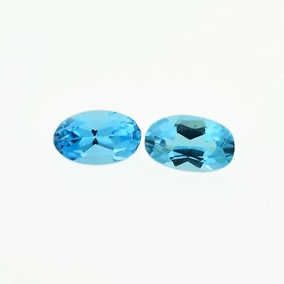 A PAIR OF 5x3mm OVAL-FACET SWISS-BLUE NATURAL AFRICAN TOPAZ GEMSTONES
