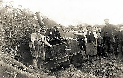 Tr 136  Steam Traction  Engine, In The Process Of Being Hauled Out Of Ditch