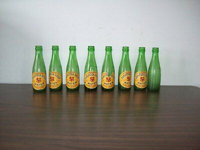 7 1960's Saratoga vichy water bottles w/ labels green 7 oz